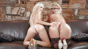 Glasses clad blonde MILF and petite blonde spinner having lesbian sex