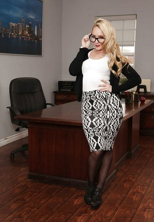Solo girl AJ Applegate stripping down to stockings and glasses in office