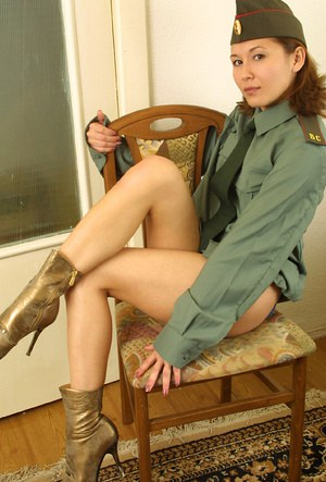 Amateur Asian babe shedding military uniform to reveal hairy cunt
