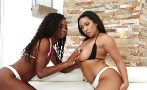 Ebony and mocha skinned lesbians Mya Mays and Priya Price baring nice asses