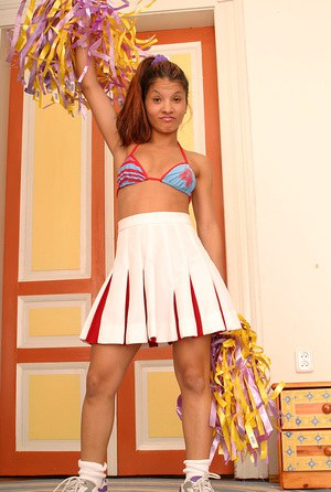 Ebony solo girl freeing tiny tits from cheer outfit for amateur photos
