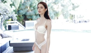 Skinny brunette babe Anna DeVille freeing big natural tits from lingerie