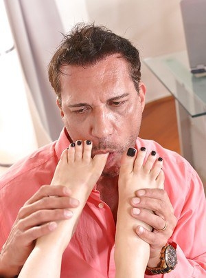 Leggy glasses wearing chick having toes sucked before giving footjob