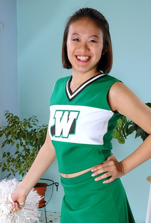 Amateur Asian freeing big tits and ass from beneath cheerleader uniform