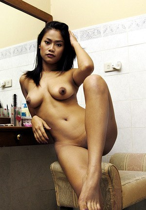 Leggy Asian babe revealing big tits and amateur pussy while stripping naked
