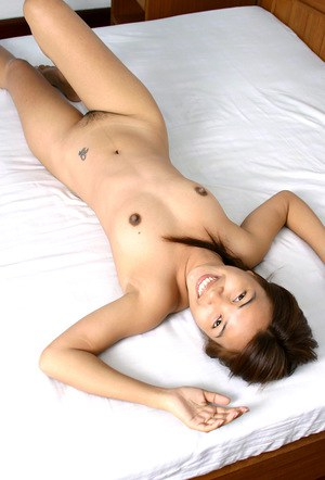 Amateur Asian babe revealing perky tits and long nipples while undressing