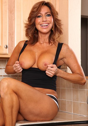Denim jeans clad aged Latina Tara Holiday revealing nice melons in kitchen