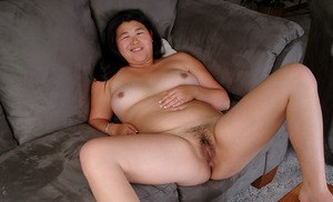 Chubby brunette amateur freeing hairy Asian pussy from denim jeans