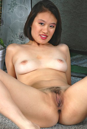 Amateur Asian babe exposing all natural tits and hairy pussy