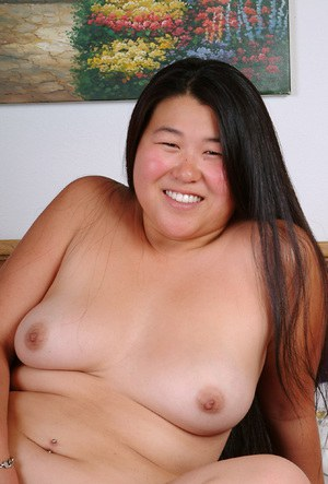 Amateur brunette fatty sliding panties aside to spread hairy Asian cunt
