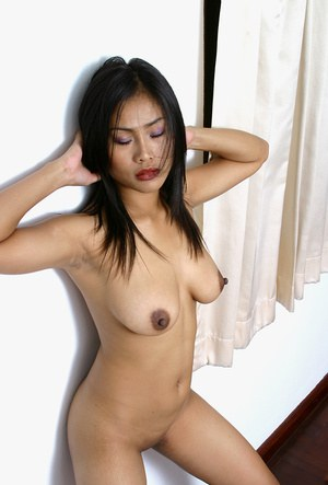 Amateur Asian babe revealing big tits and erect nipples in high heels