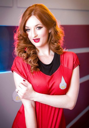 Redheaded Euro babe Zara DuRose freeing big tits from cosplay outfit