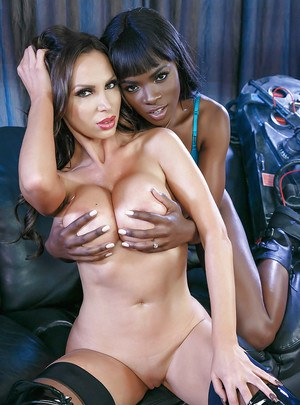 Busty moms Ana Foxxxa and Nikki Benz have interracial lesbian sex in boots