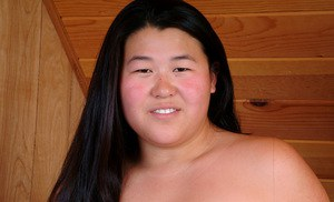 Obese amateur in stockings and lingerie revealing natural Asian boobs