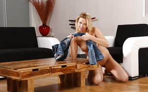 Blonde Euro babe Nikki Dream removing wet jeans after pissing herself