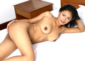 Amateur Asian solo girl with big boobs baring shaved pussy beneath skirt