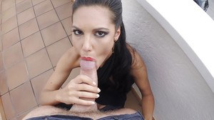 Brunette girlfriend licking big cock with tongue during outdoor blowjob