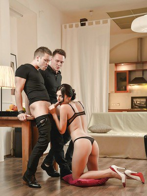 Dark haired Euro chick Anita Sparkle giving oral sex in lingerie and heels