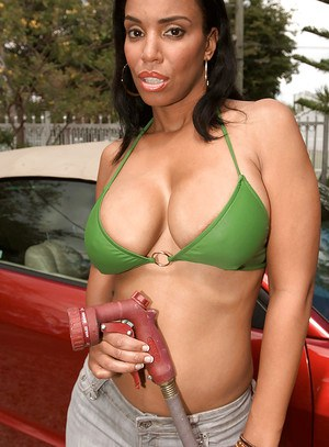 Ebony babe Soleil Hughes revealing large all natural black juggs outdoors