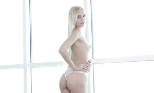 Gorgeous blonde pornstar Alex Grey stripping off panties and lingerie