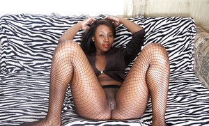 Older black chick Chiya stretching pink pussy wide open after hose removal