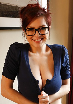 Redhead pornstar Tessa Fowler unveiling perfect knockers in glasses