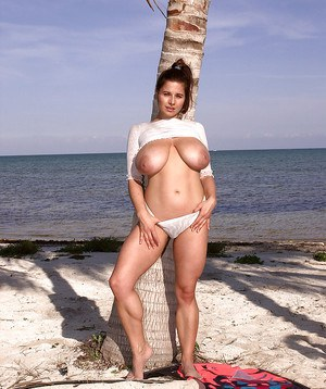 French solo model Chloe Vevrier revealing mature hooters on beach