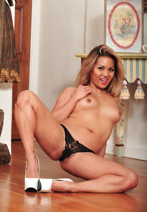 Asian solo model Lana Violet freeing tight ass from black lace panties