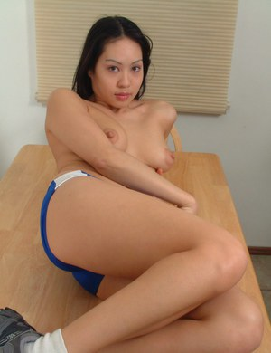 Petite Asian chick Milla freeing sexy ass and trimmed pussy from shorts