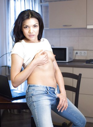 Petite Asian MILF Isha shedding jeans for wide open viewing of shaved cunt