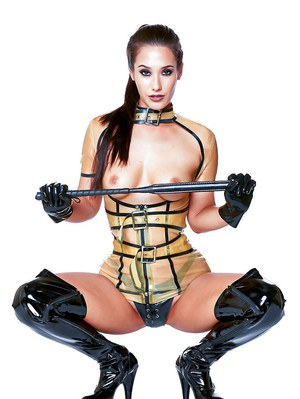 Asian beauty Eva Lovia strutting in black latex boots with riding crop