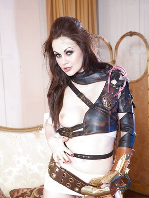 Non nude Euro model Tina Kay letting nipple slip from leather attire