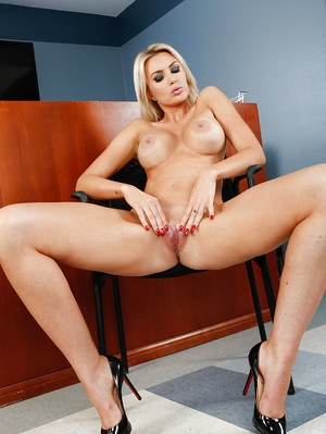 MILF pornstar Gigi Allens revealing big tits and nice ass in office setting