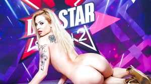 Tattooed pornstar Dahlia Sky freeing small boobs from sexy lingerie