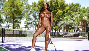Ebony MILF Diamond Jackson shows off sexy legs and big tits on tennis court