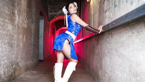 Asian solo girl Lily Love freeing small tits from cosplay uniform outdoors