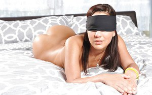 Brunette chick Amara Romani puts on blindfold before exhibiting nice ass