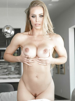 Hot blonde maid Nicole Aniston exposing large boobs in white stockings
