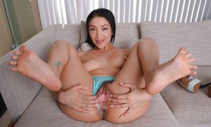 Hot Asian chick Vicki Chase removes heels from sexy feet before airing bush