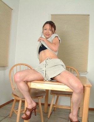 Korean first timer Lilianna slipping shorts over bare legs in kitchen