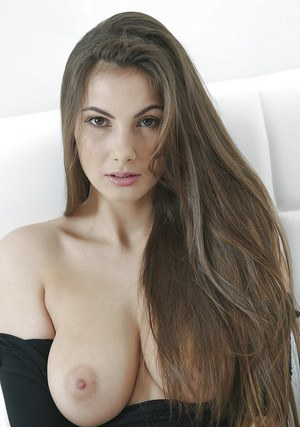 European beauty Connie Carter letting big natural tits loose from onesie