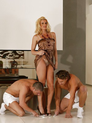 Busty blonde cougar undressed for oral and anal sex by 2 muscled men