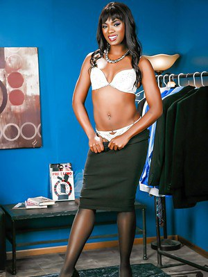 Black beauty Ana Foxxx posing in stockings after ridding black skirt