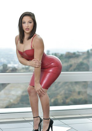 Brunette pornstar flaunting big butt in leather dress and high heels