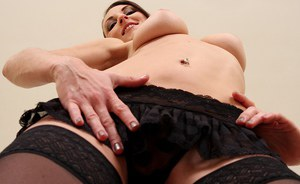 Clothed solo model Valentine Chevalier stripping down to black nylons