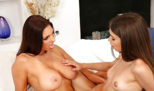 Young lesbians Riley Reid and Mindi Mink expose tits before fingering cunts
