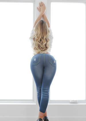 Sexy blonde model August Ames releasing juicy butt from blue jeans