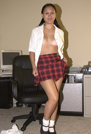 Amateur Asian Mariah releasing hairy cunt from schoolgirl skirt in office