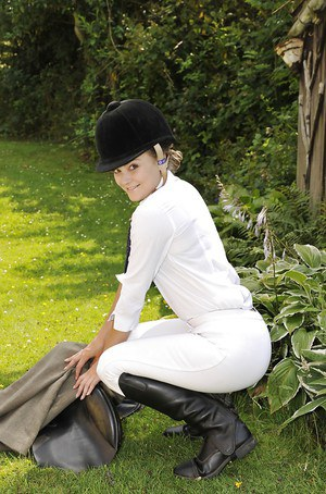 Barely legal teen Heidi Prama strips off riding outfit to pose naked on lawn