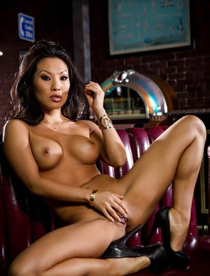 Sexy Asian pornstar Asa Akira freeing perfect tits from satin brassiere